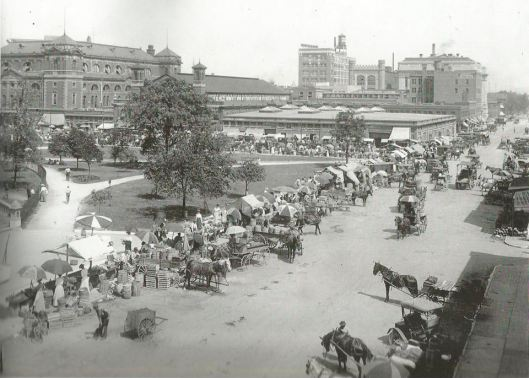 """Image of Alabama and Market street stands circa 1912. Families who had """"truck gardens"""" came here to sell their wares"""
