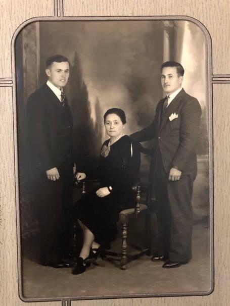 12 - three people in photo - woman sitting